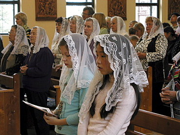 Russia - sunday mass at catholic church, yuzhno sakhalinsk, sakhalin island, russian far east