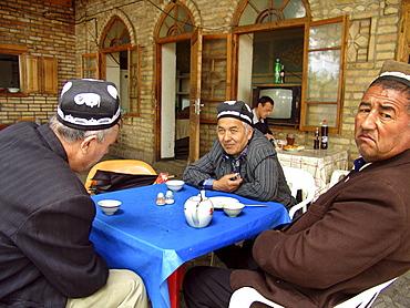 Uzbekistan men drinking tea at a chaikhana, shakhrisabz.