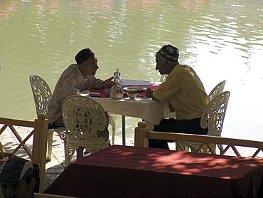 Uzbekistan men drinking tea at the lyab-i-hauz, bukhara