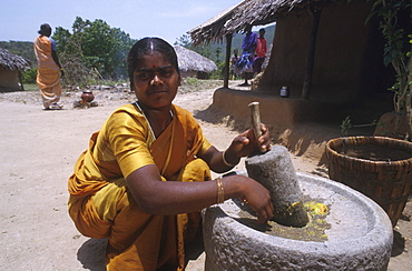India - women - labour: woman grinding chillis, tamil nadu