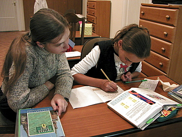 Russia orphan girls living at & martha convent moscow, doing homework