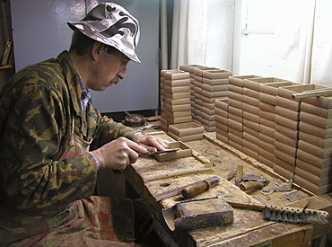 Russia man making papier mache boxes on which miniatures be painted palekh