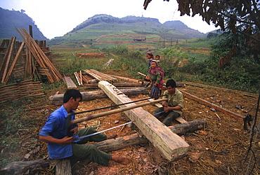 Labor men sawing lumber to boards, bo, lao cai, vietnam