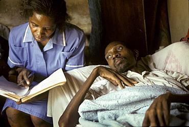 Uganda patient being cared for by mobile nurse nsambye hospital, kampala