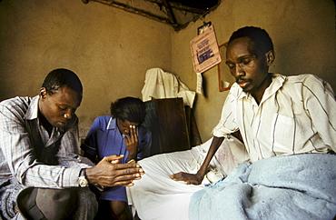 Uganda mobile health nsambye hospital, kampala, praying man who has
