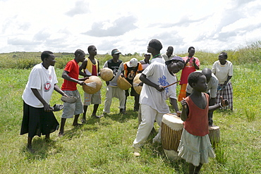 UGANDA The work of Comboni Samaritans, Gulu. The Gwoke Ber AIDS support group. They keep up their spirits by music and dance, and also perform drama skits to teach about avioding AIDS in the local villages. PHOTO by Sean Sprague
