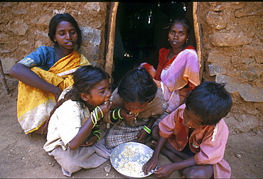 India - slavery children of bonded laborers eating, tamil