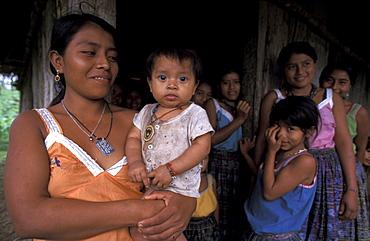 Guatemala qeqchi women and children at sechin village, peten