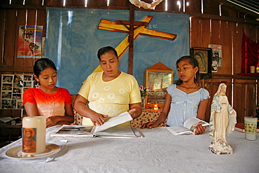 Guatemala santa rita village of returnees, in peten. community fled guatemala during violence of 1980s in times of peace have returned to settle in jungle lowlands. Liturgy of word celebrated at a small catholic chapel in village