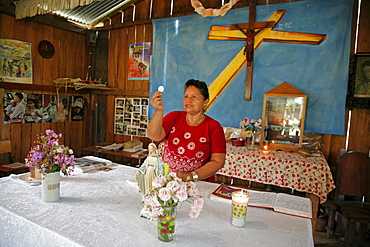 Guatemala santa rita village of returnees, in peten. community fled guatemala during violence of 1980s in times of peace have returned to settle in jungle lowlands. Liturgy of word celebrated at a small catholic chapel in village. Eucharist minister elvira de jesus corado