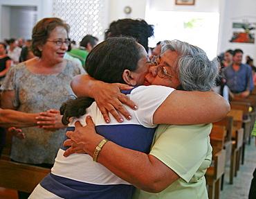 Honduras of peace during catholic mass. slum barrio of chamelecon, pedro sula