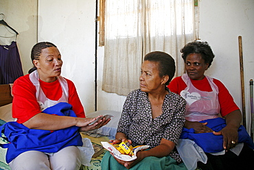 Namibia voluntary home visitors catholic aids action visiting a sick woman with at home in rehobeth. They provide with arvs (anti retro viral) medicines which made in india