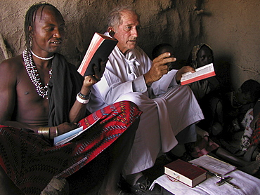 Watatulu tribals at catholic mass, tanzania. - with father dan ohman in a hut in mwankale
