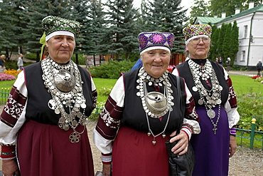 Russia women wearing traditional estonian dress at pechersky caves monastery, pskov district, founded on august 28th 1473 by saint jonah sheshnik