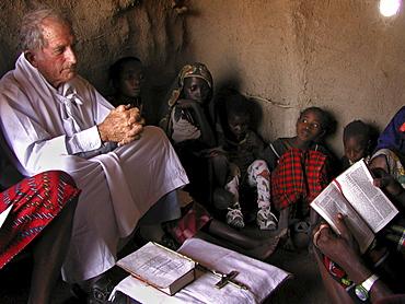 Watatulu tribals at catholic mass, tanzania. - with father dan ohman in a hut at mwankale