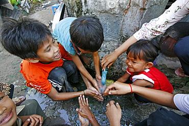 Children washing hands prior to eating, phnom pen