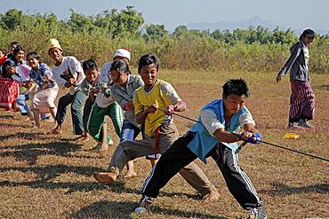 Myanmar school children enjoying a of game, myitkyina, a largely kachin community in north burma near chinese border