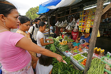 Philippines fruit and vegetable seller in a street market at bagong silangan, quezon city, manila