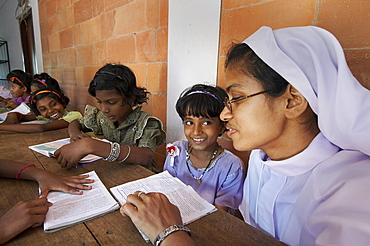 India. Study and reading time, helped by sister bincy joseph.Mary Matha bala bhavan, a girls orphanage run by syro-malabar catholic missionary sisters of mary immaculate (msmi), chamal village, thamarassery diocese, khozikode, kerala. 2007