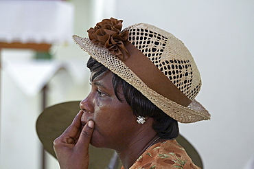Jamaica. Woman at sunday mass at catholic church in chester castle