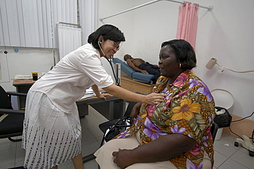 Jamaica. Doctor examining patient in clinic at montego bay