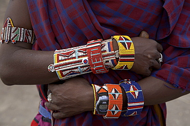 Kenya. Details of beads and watch worn by masai man at a masai village within the amboseli national park. Photo by sean spragu