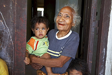 East timor. Camp for internally displaced people (idps) in the old hospital at baucau. Jacinta marques, and old woman and children at the camp
