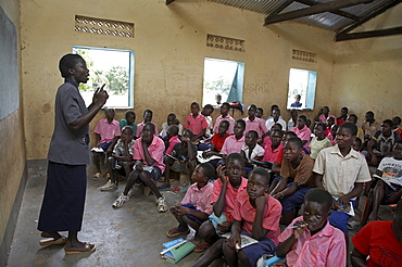 South sudan lutaya primary school, constructed and financed by jesuit refugee services since 2005, yei. lesson taking place in one of the classrooms. some classes have over 100 children. most classes do not have desks or seats. children often bring their own stools to sit on