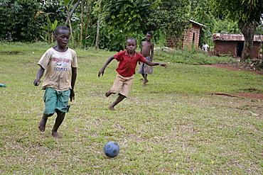 Uganda boys playing footbal, kayunga district