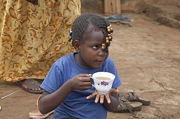 Uganda the home of ntanda miria, kayunga district. enjoying a relaxing breakfast outdoors