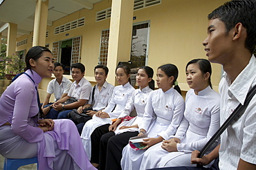 Vietnam anti trafficking project at tra on in vinh long province in the mekong delta region of vietnam. many young people have succumbed to bein.  for marriage or work in neighboring countries, and this project addresses the problem. in this image the vice-principal of tra on high school, ngoc bich, talks to a group of 12th graders about the problem