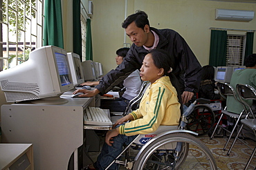 Vietnam crs (catholic relief service) work with people with disabilities extends into the college system with a project of inclusive education. at the hanoi college of it, shown here, there are 25 students with disabilities and 15 visually impaired. crs provides special mobility equipment such as wheelchair ramps, and with a joint grant shared by other funding agencies, provided an elevator at the college (seen here), so that wheelchair bound students could move easily to other floors of the building