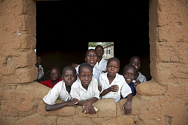 Tanzania school children looking out of window of classroom, kalabezo