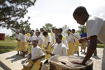 Tanzania school children dancing and playing drums on world aids day, kalabezo