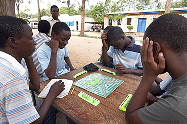Tanzania boys playing scrabble, recreation center, musoma