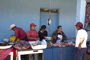 Guatemala local maket at lemoa, el quiche. butchers stall