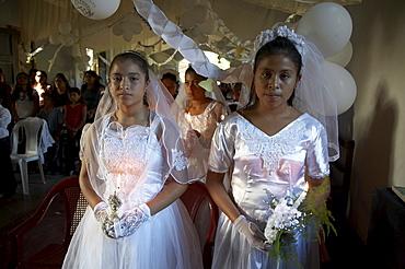Guatemala catholic first communion and mass at remate, el peten. girls during mass