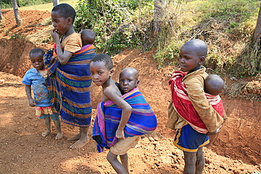 Burundi small children carrying even smaller children. Gitera.