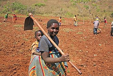 Burundi woman carrying a hoe, gitera.