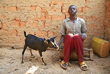 Burundi boy with goat, gitera.