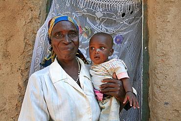 Burundi woman and her grandchild, bujumbura.