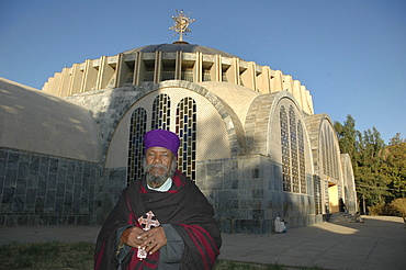 Religion, ethiopia. Kesegedez walde giogis, head priest of saint mary of zion churches. He is standing in front of the new church. Axum