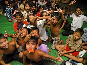 CAMBODIA Children receiving first aid by an outreach team of CSARO, central Phnom Penh