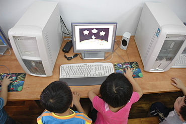 Education, taiwan. Children at a day care center in taichung, using computers