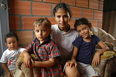 Colombia single mother with her children, barrancabermeja. Beautiful people, but they are extremely poor, and the children both suffer from malnutrition and stunted growth. She often does not send them to school becasue they are too hungry