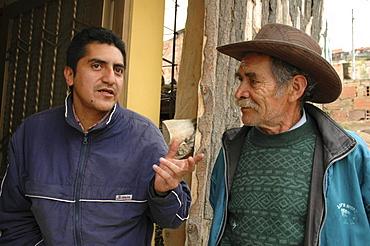 Colombia social worker visits slum dwellers, altos de cazuca, bogota