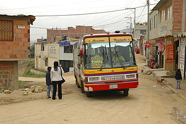 Colombia city bus in the slum development at altos de cazuca, bogota