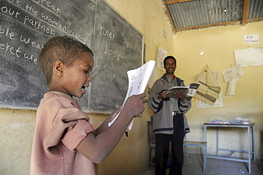 Ethiopia catholic elementary school at wutafa, tigray. Boy reading english