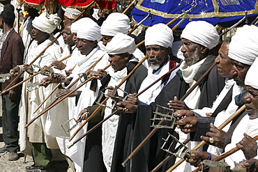 Ethiopia turbanned, married orthodox priests chanting and dancing during the feast of mary, axum
