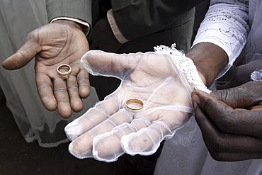 Kenya at a wedding mass, kibera slum, nairobi. Three couples were married at the same time, by american maryknoll priest, father bob jalbert